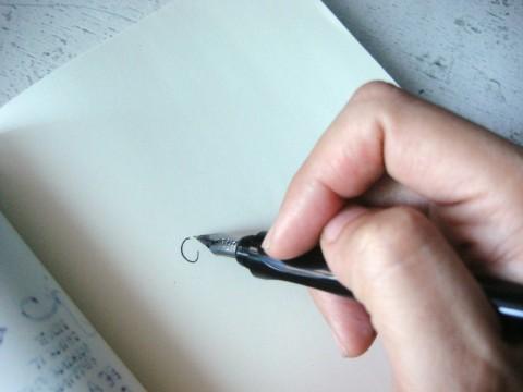 Squid pen in hand