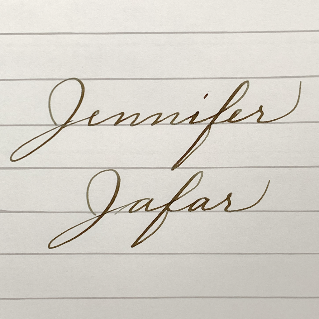 """Jennifer"" and ""Jafar"" written in cursive"